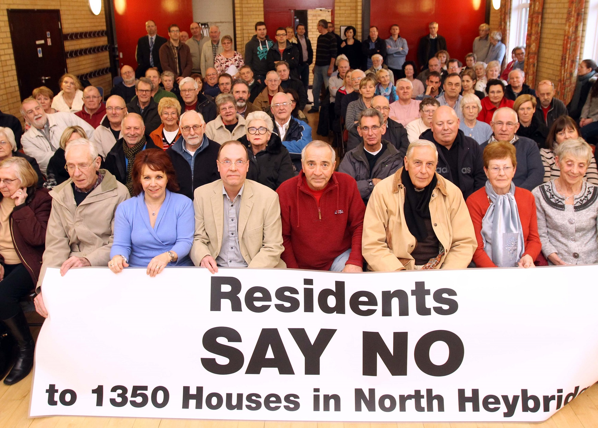 Angry residents pack out hall to fight housing allocations