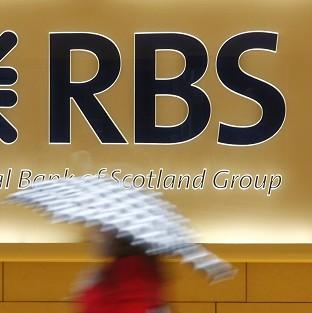 Royal Bank of Scotland has handed out shares worth up to �18.2 million for its top management