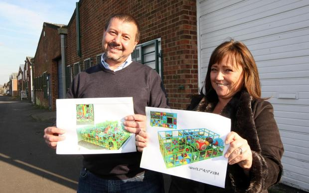 Ian and Louise Cubberley with plans for their new play centre