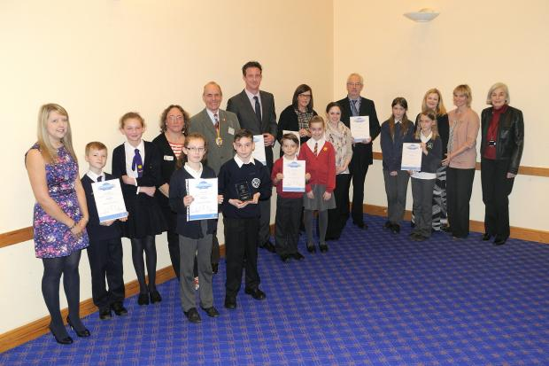 Representatives from the schools with their awards