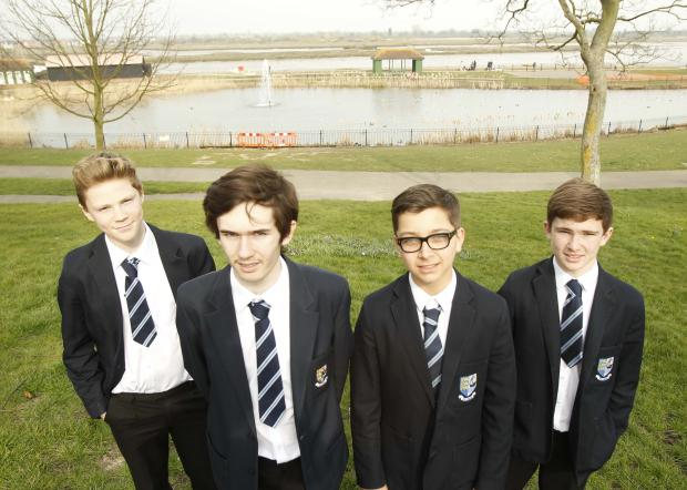Maldon and Burnham Standard: Plume School pupils Tom Amner, George Barton, James Harris and Kye Hedgecock at Maldon Prom Park lake