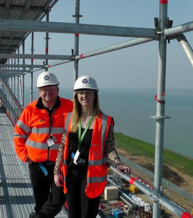 Site director and reporter Emma Robinson on the roof of Bradwell power station