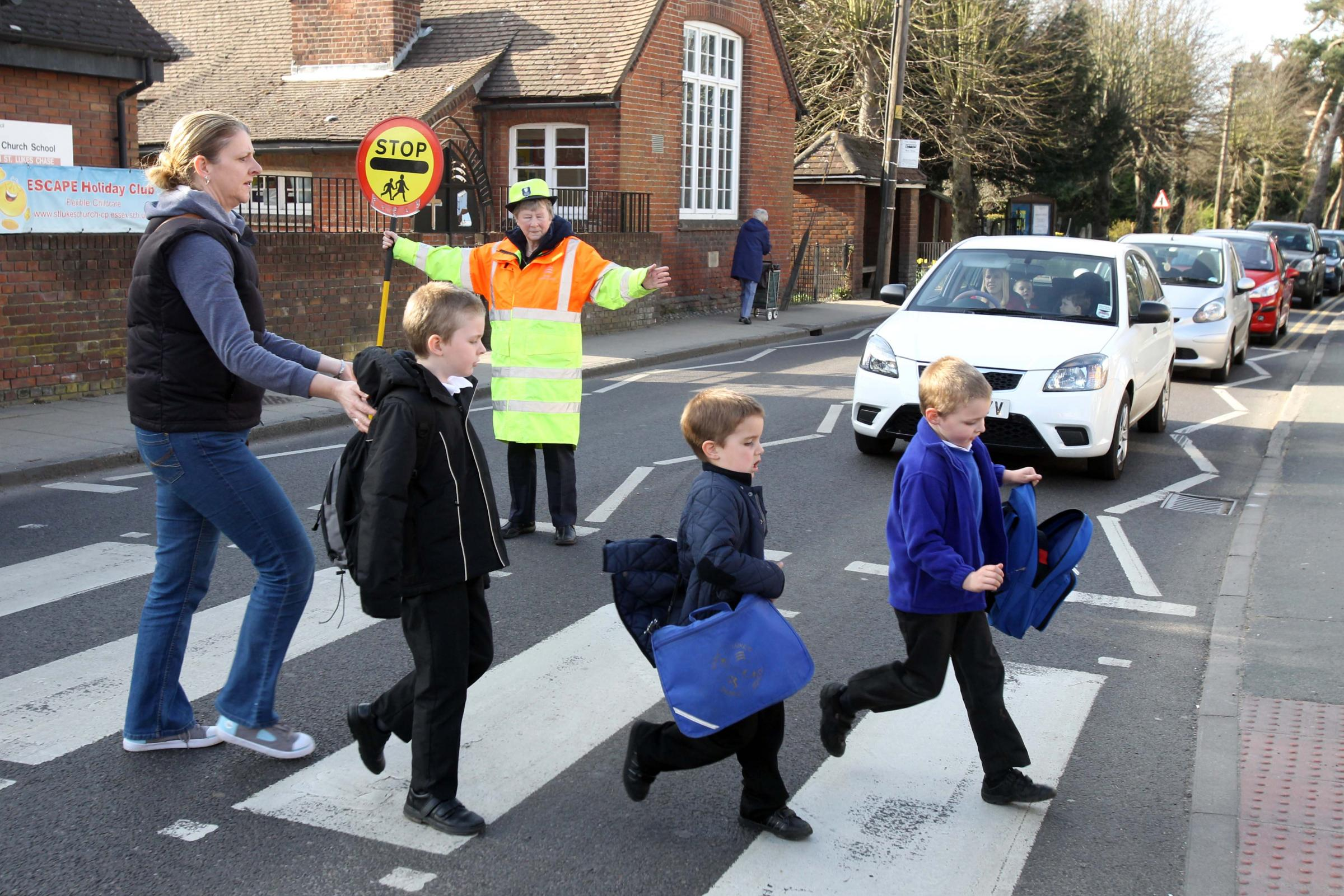A Tiptree lollipop lady in action