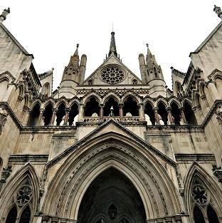 A High Court judge has praised a woman with drink and drug problems who agreed an adoption plan for her young son