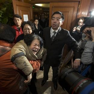 Maldon and Burnham Standard: Relatives react after hearing the news in Beijing (AP)