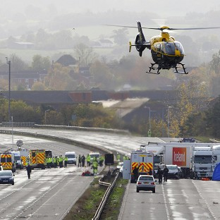 Emergency services work at the scene on the M5 motorway close to Taunton following the pile-up