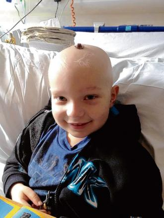 Laughlin Whiteley, having fun with a toy Lego hat on his head, could be home soon