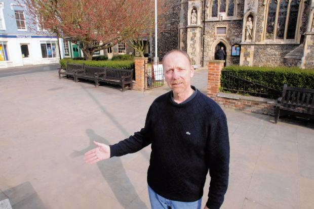 Maldon and Burnham Standard: Town councillor Mark Heard outside All Saints Church, which he believes is the best spot for Maldon's market