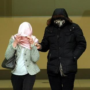 Mafia fugitive Domenico Rancadore, pictured with his wife Anne covering their faces at a previous court hearing, has been remanded in custody.