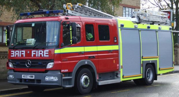 Man rescued from flat fire after being trapped