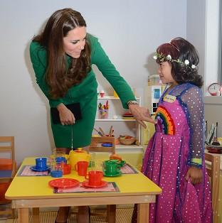 Maldon and Burnham Standard: The Duchess of Cambridge meets Bailey Taylor, six, during her visit to the Rainbow Place Children's Hospice in Hamilton, New Zealand
