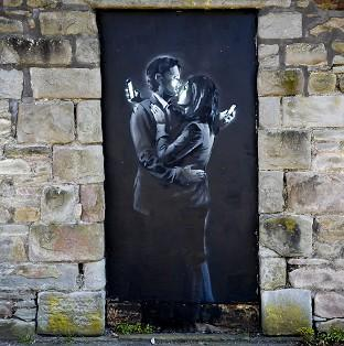 David Stinchcombe, a youth centre leader, moved the Banksy artwork from a wall in Clement Street, Bristol