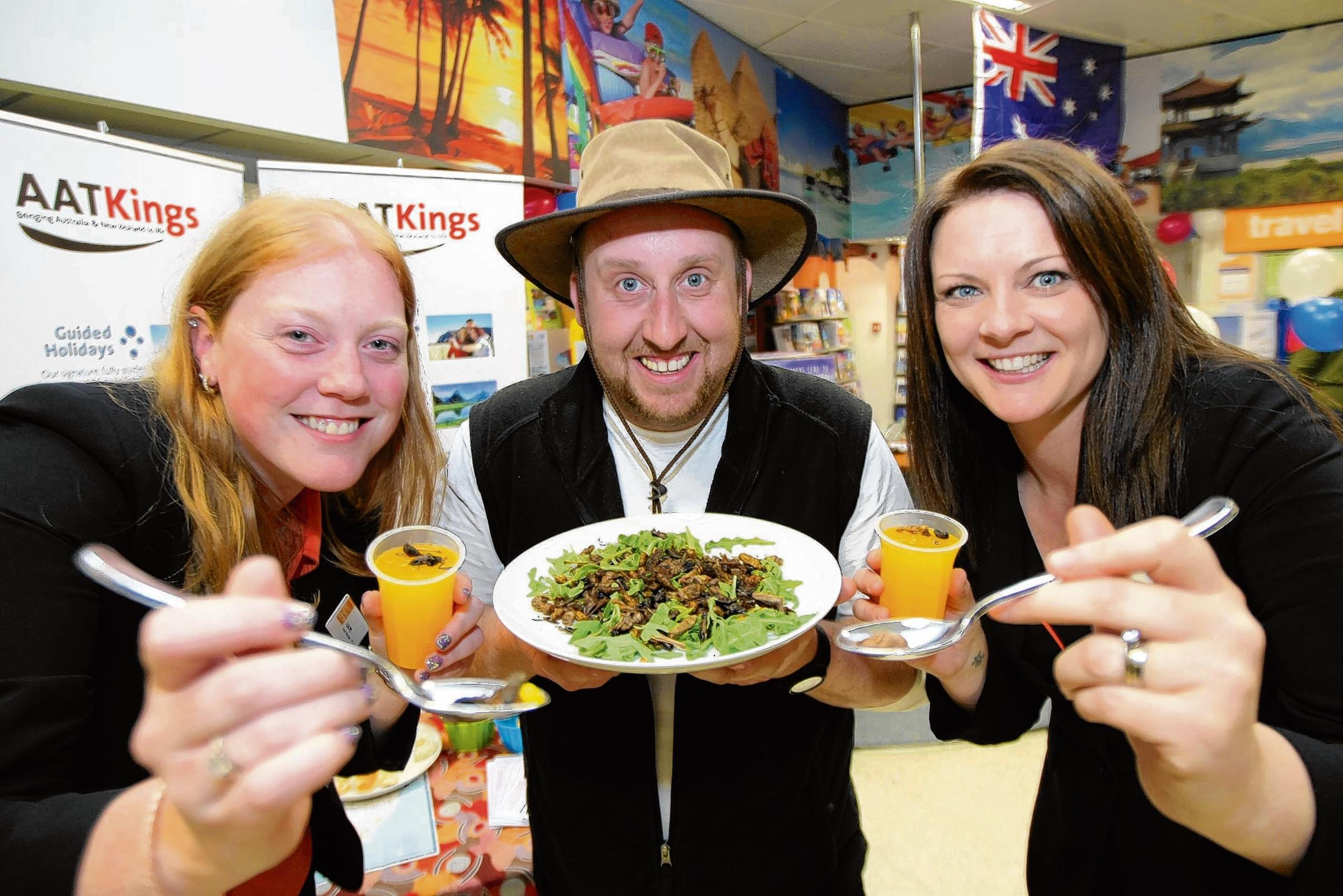 Stacey Turland, Andy Austen and Julie Cook sample some bushtucker