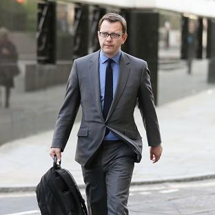 Former News of the World editor Andy Coulson arrives at the Old Bailey, as t