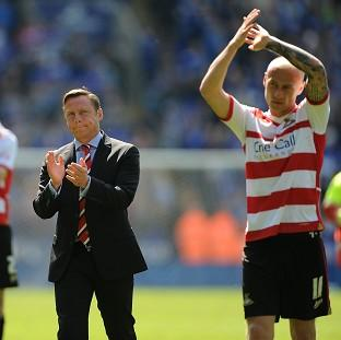 Doncaster Rovers manager Paul Dickov and members of the team applaud the travelling fans after the game against Leicester City