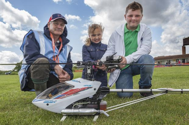 Denis the Helo pilot shows the control to Riley and Slater Marrison. Picture by David Davies