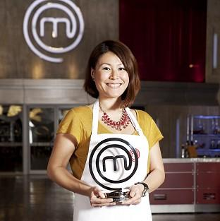 Maldon and Burnham Standard: MasterChef 2014 champion Ping Coombes shows off her trophy (Plank PR/PA)