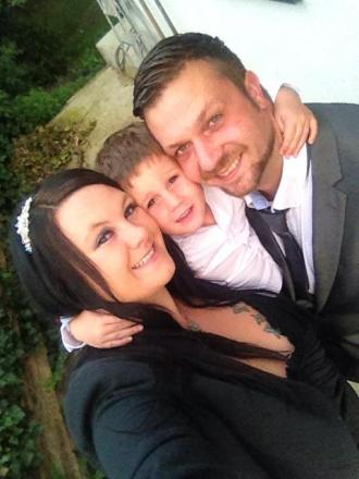 Mandi Deakin with son Kayden, four, and husband Ben