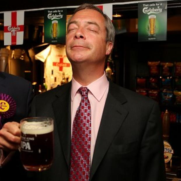 Maldon and Burnham Standard: Ukip leader Nigel Farage enjoys a pint in the Hoy and Helmet pub in South Benfleet, Essex, as his party makes election gains