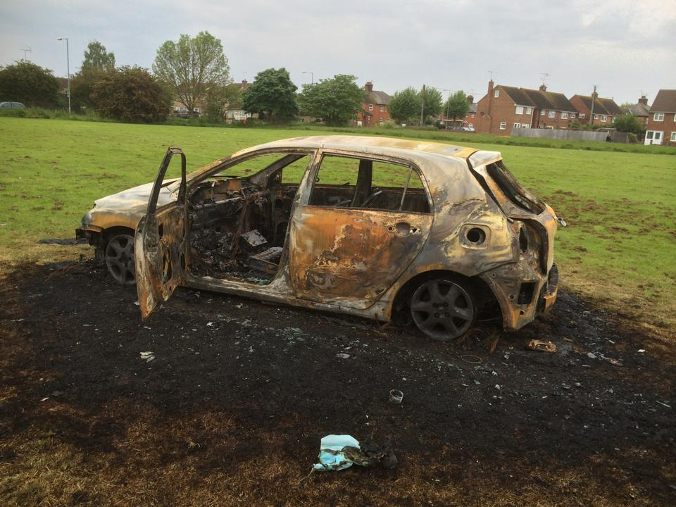 The burnt out car on Primrose Meadow. Photo submitted by Richard Buckby.