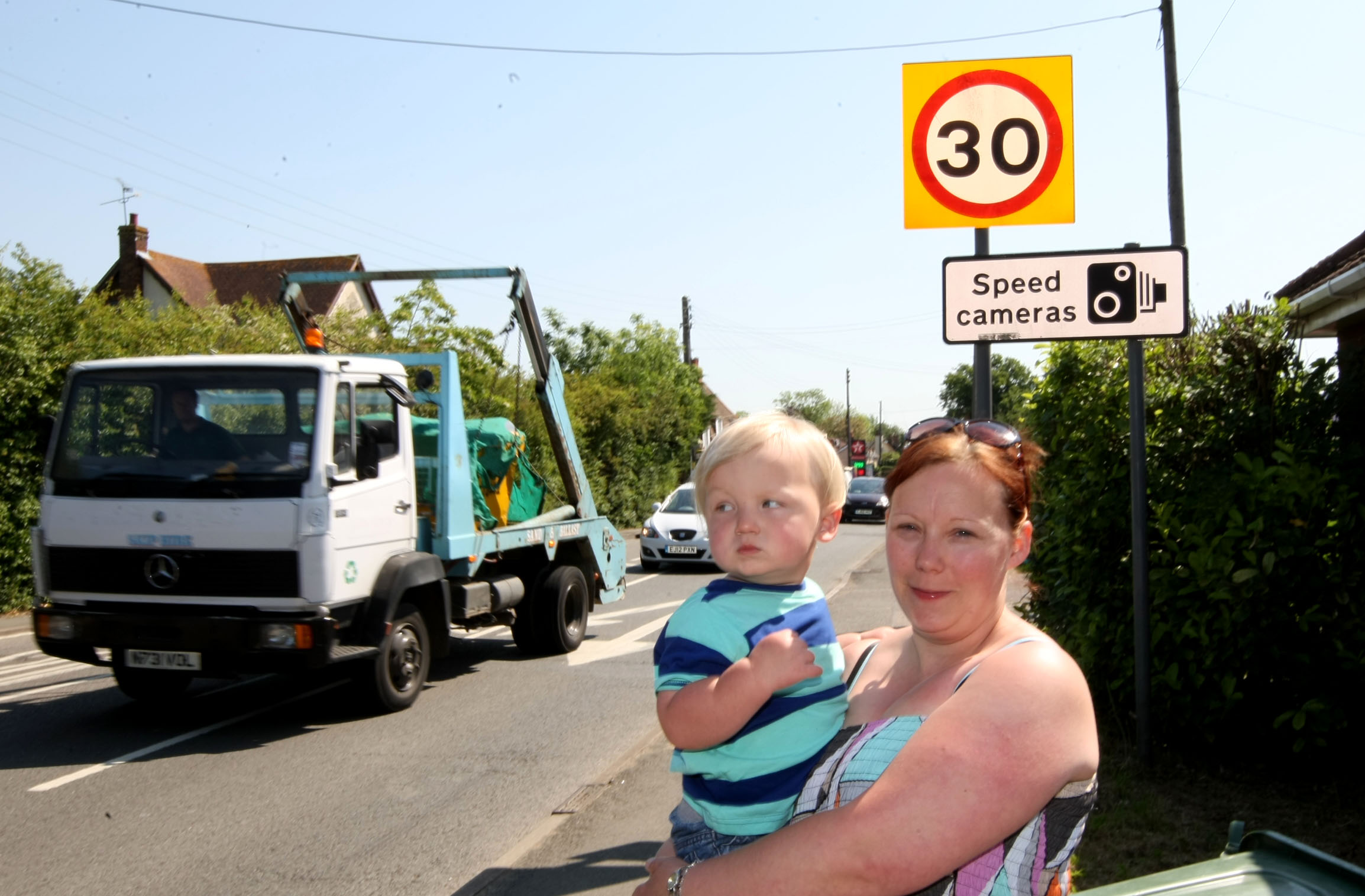 Louise Pallister with two-year-old Rylee next to the 30mph sign