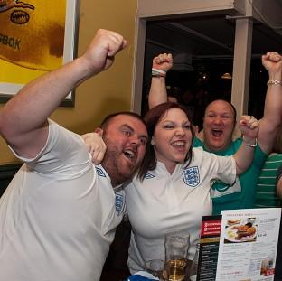 England fans cheer their team in the pub