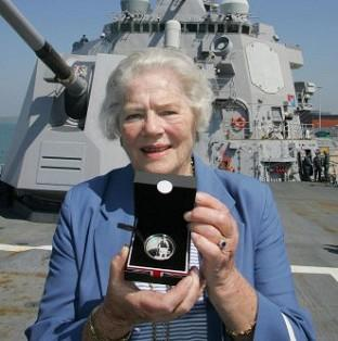 Maldon and Burnham Standard: Lady Mary Soames, daughter of Sir Winston Churchill, has died aged 91. She is pictured holding a coin commemorating her father aboard the USS Winston S Churchill which was docked in Portsmouth.