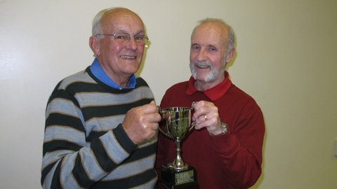 Bryan Littlewood, left, receives his trophy from club competition officer Mike Saucede
