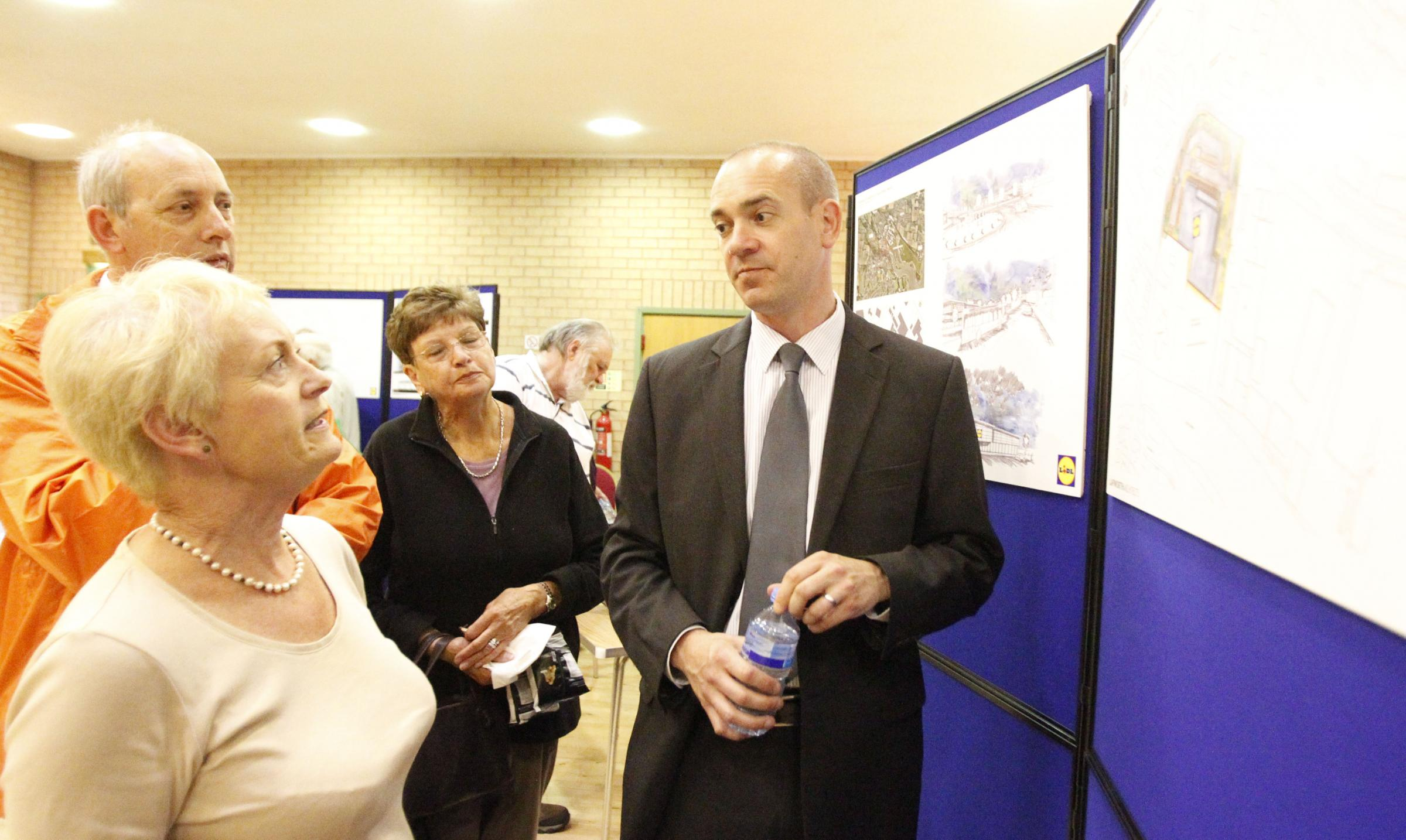 Christian Barber looking at Lidl plans with Maldon residents