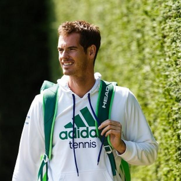 Maldon and Burnham Standard: Andy Murray arrives for the start of a practice session ahead of Wimbledon