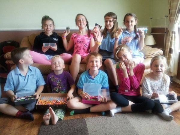 Melanie Naunton's children and friends, with the loom bands they are making for charity