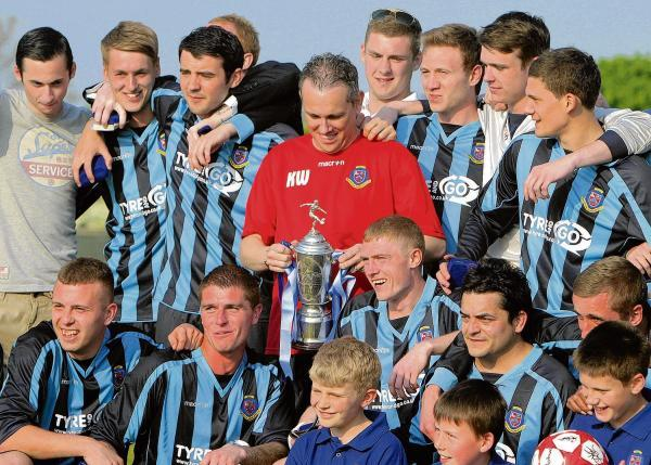 All change - Keith Wilson (centre), pictured celebrating trophy success with Burnham Ramblers, is the new Heybridge Swifts manager.