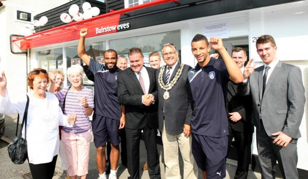 Ron Pratt with members of Colchester FC and Simon Warren, branch manager at the reopening of Bairst