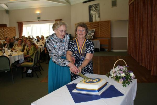 Eveline Sadler, in her 90s, together with the President of The Inner Wheel Club of Maldon, Pam Byford cutting the anniversary cake