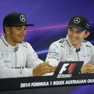 Nico Rosberg, right, has apologised for his collision with Lewis Hamilton at the Bel