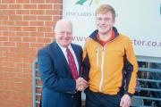 WELL DONE: Five Lakes Captain Roger Hyman congratulating Billy Coe on his Winter League third round success.