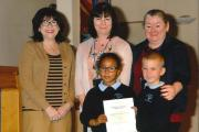Pupils Aisha Blizzard and Adam Smith collected the award with head teacher Karen Harden and wellbeing coordinator Cathy Mische, from Councillor Ricki Gadsby