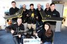 Geocurve drone at Tollesbury- staff from back, Andrew Mitson, Gary Nel (director) Nathan Meakin, Perran Banner (director), Terry Haines and Sam Treloar front, Phil Swart and Viviana Cirstean with multi blade and fixed wing drones