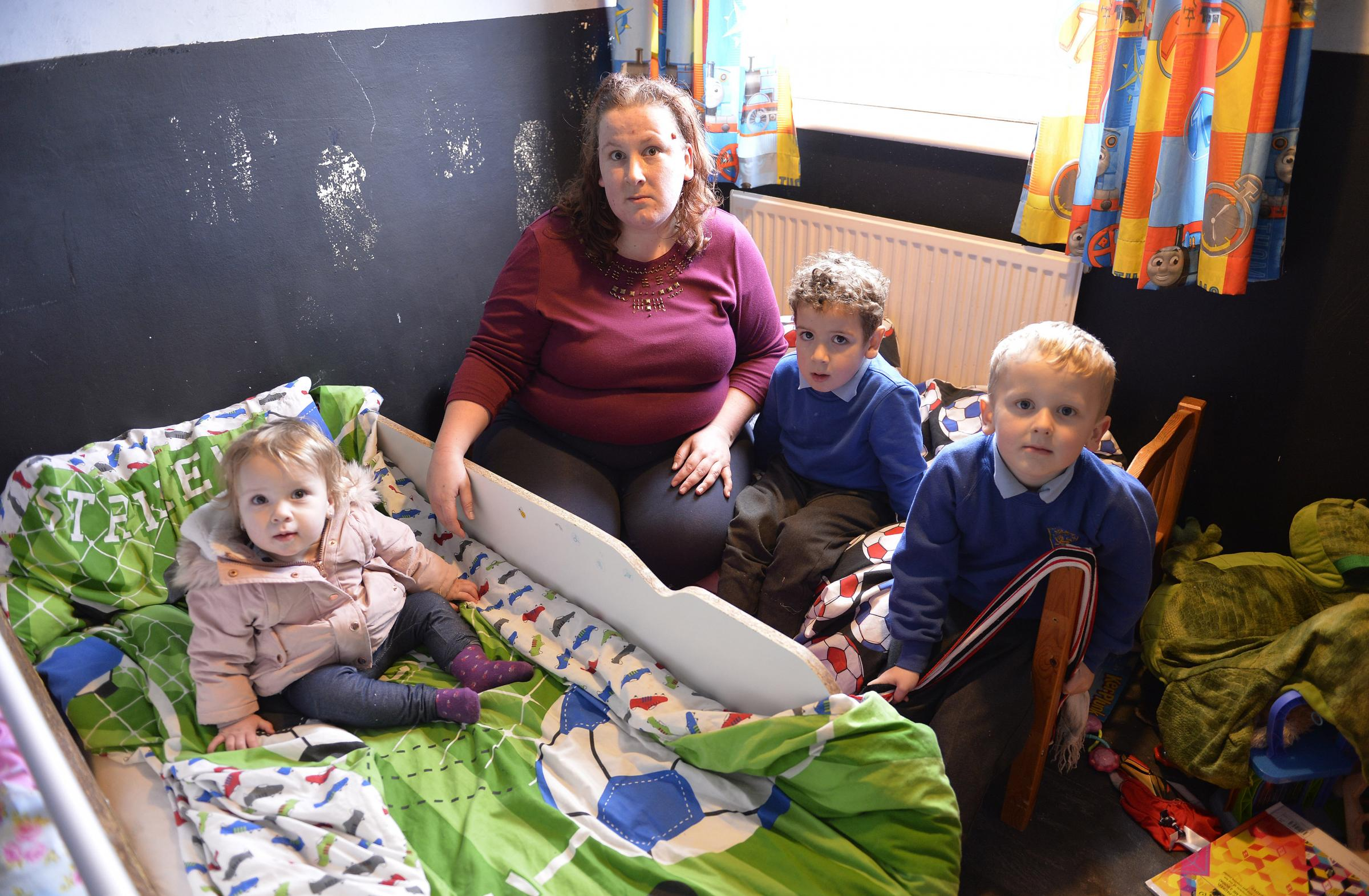 Worries - mum Louise Webber with her children, Oliver, 5, Oscar, 4, and Keeley, 17 months