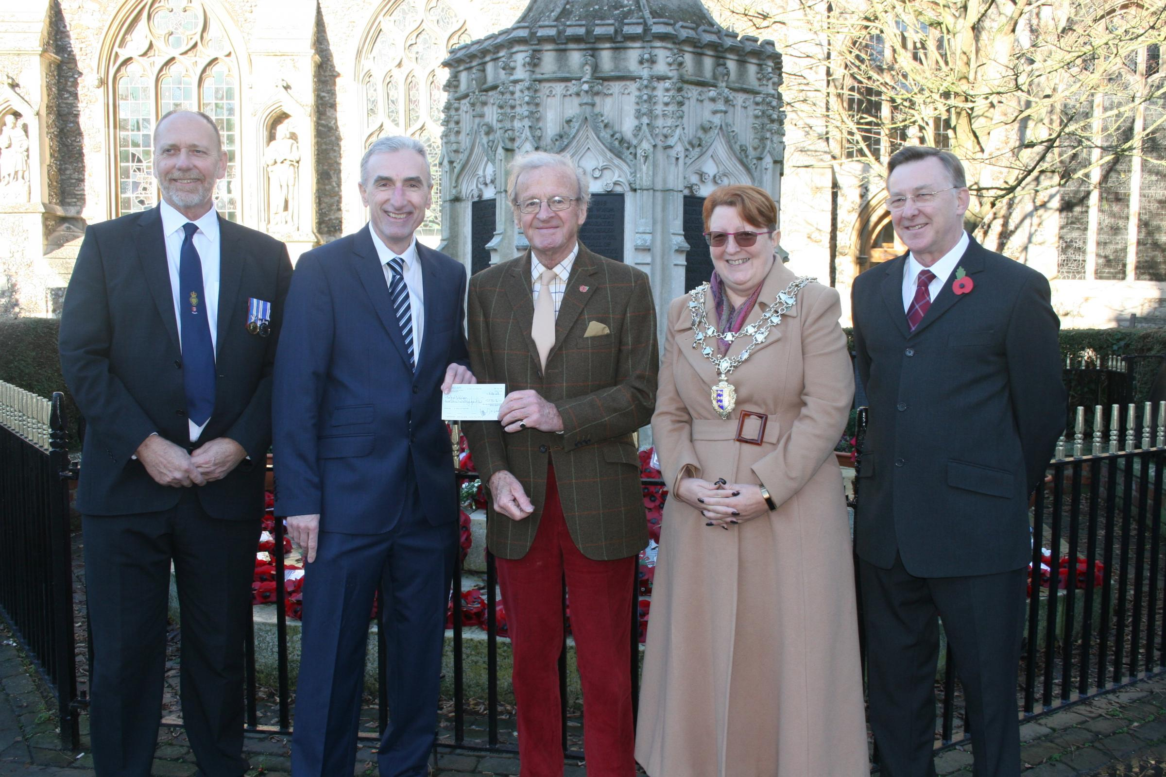 CHEQUE MATES: Councillor Mark Heard, writer and director Neil Fisher, Poppy co-ordinator Sholto Morton, Mayor Jeanette Stilts and orchestra director Ron Bewers