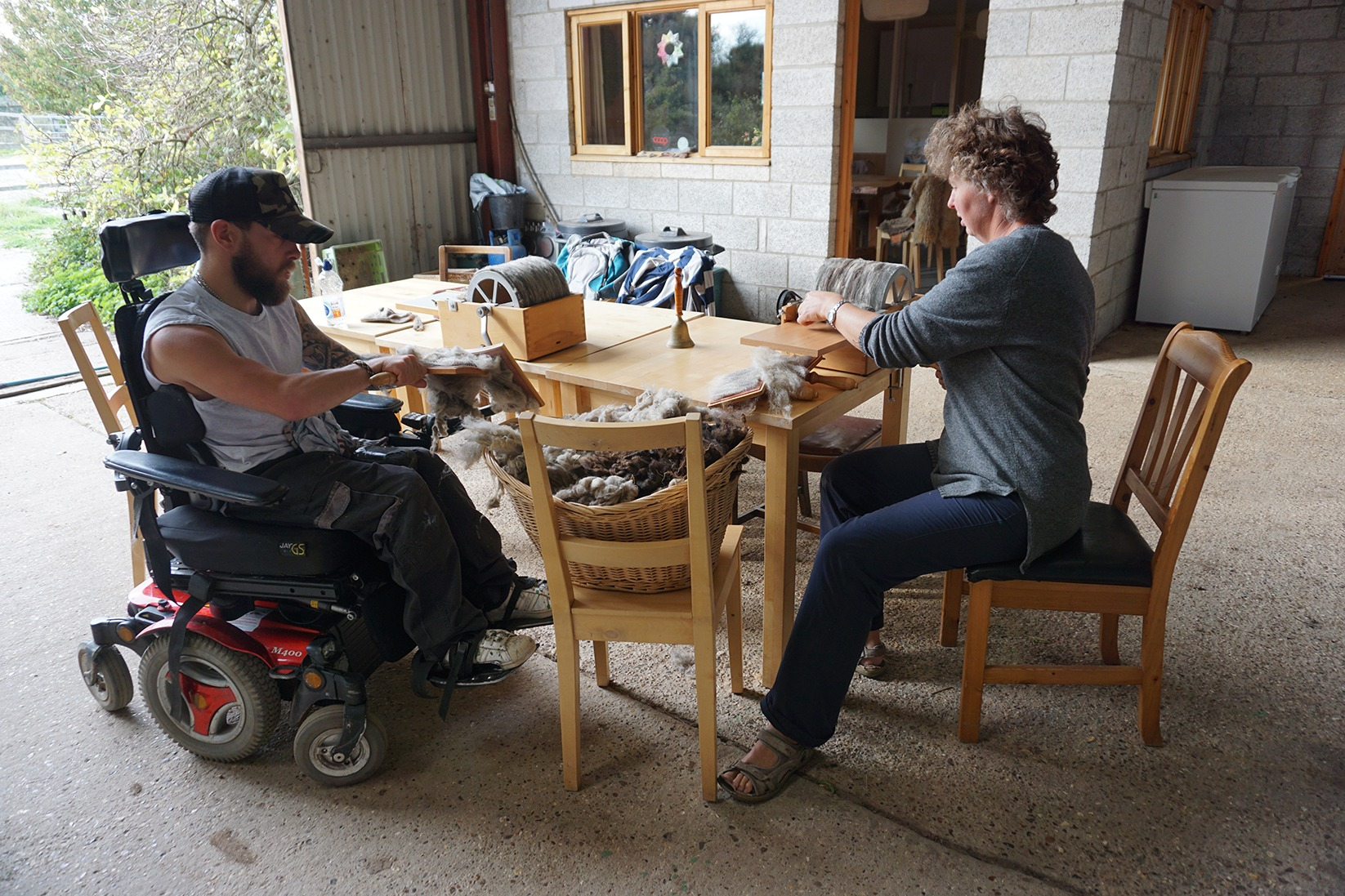 HELPING HAND: Tom Stentiford and Lois Gardner carding wool