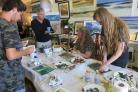 ART ATTACK: Tony Wilkerson (centre), pictured teaching at one of his workshops, hopes the Red Roof Gallery can be saved