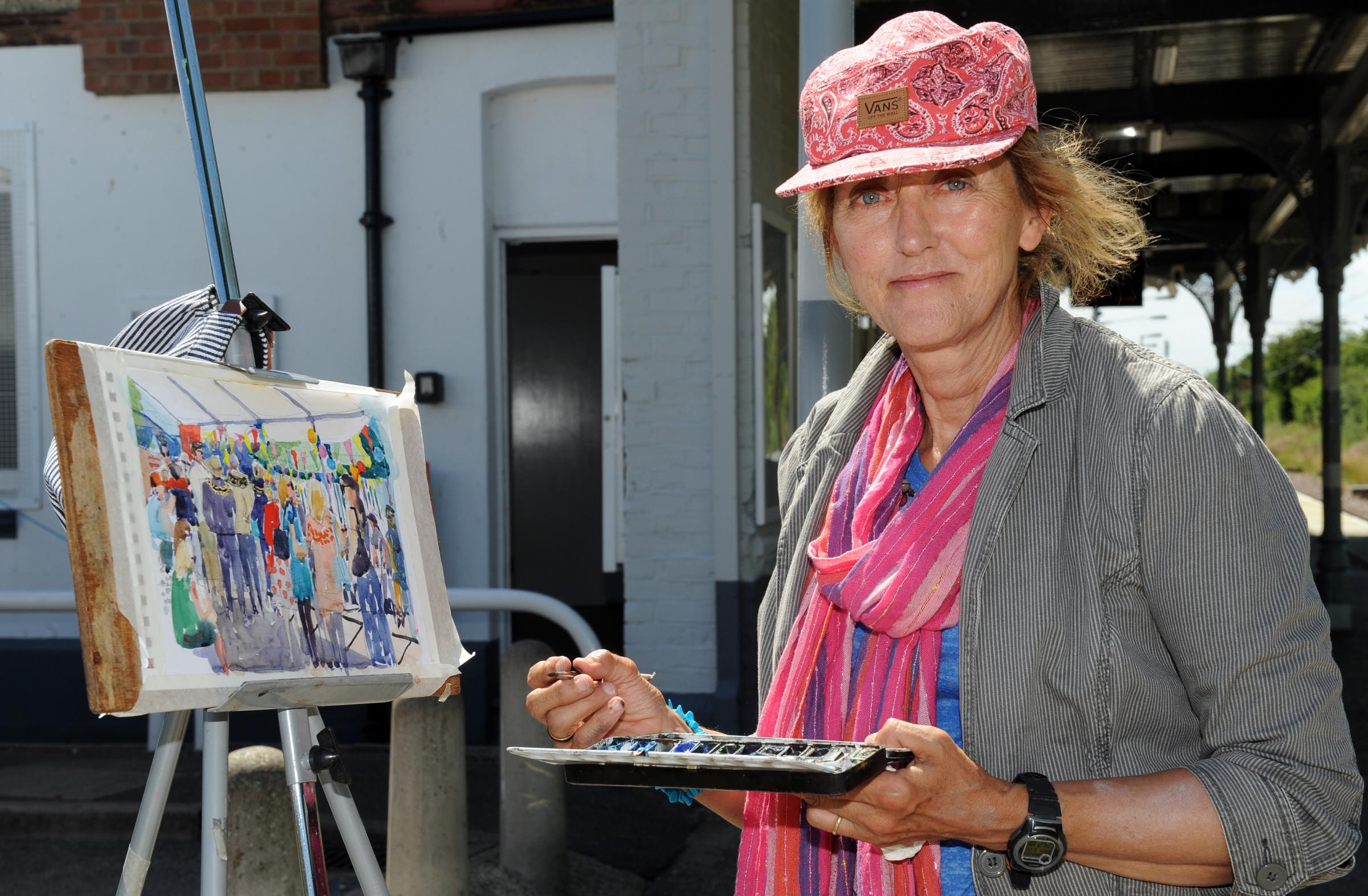 BRUSH STROKES: Artist Sue Spiers paints visitors at the opening of last year's trail