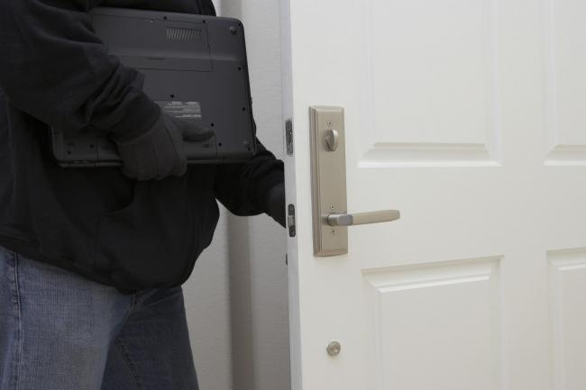 A Generic Photo of a burglar stealing a laptop from a house. See PA Feature TOPICAL Burglars. Picture credit should read: PA Photo/thinkstockphotos. WARNING: This picture must only be used to accompany PA Feature TOPICAL Burglars...