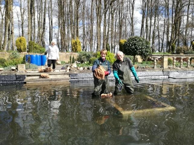 Clean up: Volunteers work on the lilypond