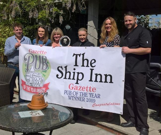 WINNERS - The staff at The Ship Inn in Tiptree; owner Michael Beard, Leanna Pennick, Louise Pennick, Sarah Tuffin, Sam Lambert and Craig Driver